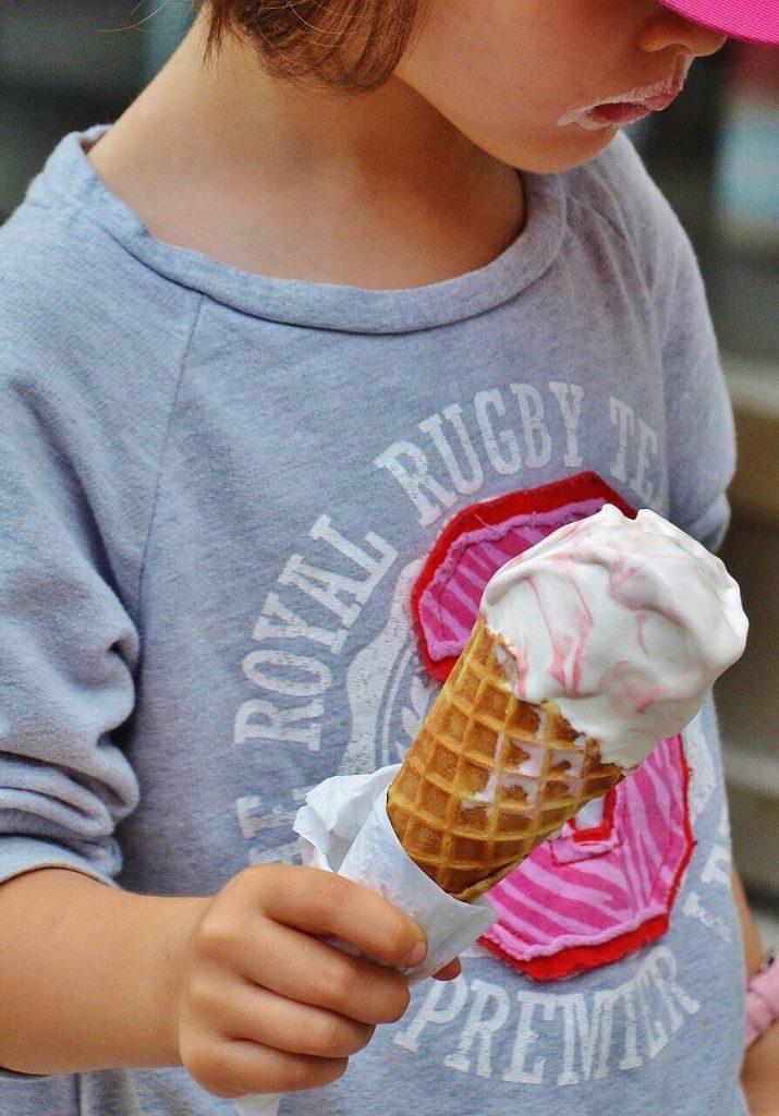 Kid eating Jane's Ice Cream at the Woodstock New Paltz Art & Crafts Fair