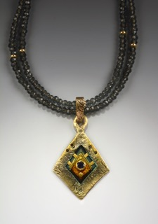 Helen Hosking, Textured Diamond Pendant, 18kgold and 24kgold, on blue quartz, handmade jewelry