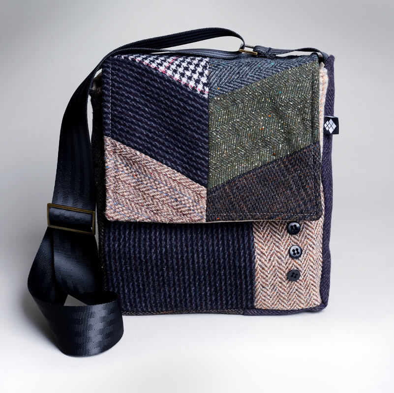 JENCI by Jennifer Couch. Recycled fibers are hand dyed, quilted, distressed, designed and sewn into one-of-a-kind bags.